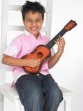 Junge mit Gitarre Lizenzfreies Stockbild
