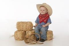 Junge mit Hut und Sattel Stockfotografie