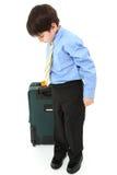 Junge mit Koffer über Weiß Stockfotos