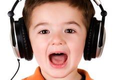 Junge mit Kopfhörern Stockbilder