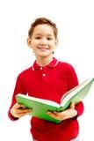 Junge mit Lehrbuch Stockbild