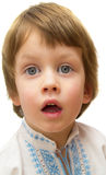Überraschungskonzept - Junge mit lustigem überraschtem Ausdruck auf weißem Hintergrund Stockbilder