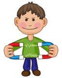Junge mit Magneten Stockbild