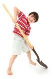 Junge mit neuem Schaufel-Spaten Stockbilder