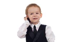 Junge mit Telefon Stockbild