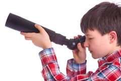 Junge mit Teleskop Stockbild