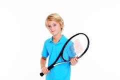 Junge mit Tennisschläger vor weißem Hintergrund Stockbild