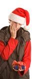 Junge mit unerwünschtem Geschenk lizenzfreie stockbilder