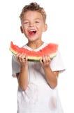 Junge mit Wassermelone Stockfotos