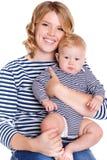 Junge Mutter, die mit ihrem kleinen Sohn spielt Lizenzfreie Stockbilder