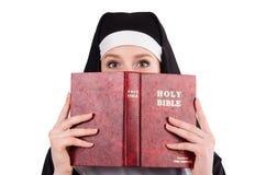 Junge Nonne mit Bibel Stockbild