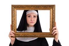 Junge Nonne mit dem Rahmen lokalisiert Lizenzfreie Stockbilder