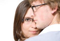 Junge Paare in den Gläsern, im Mann und in der Frau auf Weiß Lizenzfreie Stockfotografie