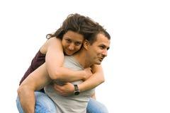Junge Paare, die auf einem Weizengebiet spielen Stockfoto