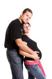 Junge Paare, die ein Schätzchen warten stockfotografie