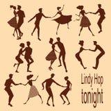 Junge Paare, die lindy Hopfen tanzen stockfoto