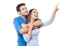 Junge Paare, die oben zeigen Lizenzfreie Stockbilder