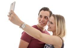 Junge Paare, die selfie machen Lizenzfreie Stockfotografie