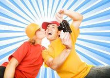 Junge Paare, die sich fotografieren Lizenzfreie Stockfotografie