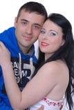 Junge Paare getrennt gegen Weiß Lizenzfreies Stockfoto