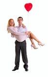 Junge Paare mit dem Innerballon getrennt über Whit Stockfoto