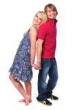 Junge Paarholdinghände und -c$lächeln Lizenzfreie Stockbilder