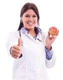 Junge pflegen das Halten des Apfels und des Fingers oben lokalisiert Stockfotografie