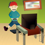 Junge playin Spielkonsole Lizenzfreies Stockbild
