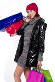 Junge Redheadfrau geht Feiertagseinkaufen Stockfotografie