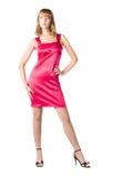 Junge reizvolle Frau im rosafarbenen Kleid Lizenzfreie Stockfotos