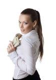 Junge reizvolle Geschäftsfrau nehmen ein Bündel Dollar lizenzfreie stockfotografie
