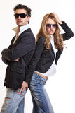 Junge reizvolle Paare, die im Studio aufwerfen Lizenzfreies Stockfoto