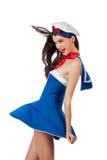 Junge reizvolle Seemannfrau im Wind Stockfotos