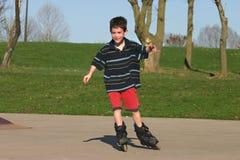 Junge Rolle-Beschaufelung Stockfotos