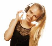 Junge süße begabte Jugendliche beim Kopfhörer-Gesang lokalisiert Stockbild