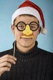 Junge Santa Claus in einer Maske Lizenzfreie Stockfotografie