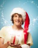 Junge Santa With ein Geschenk lizenzfreies stockfoto