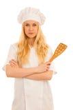 Junge schöne blonde Cheffrauenstellung lokalisiert über weißem b Stockfotos