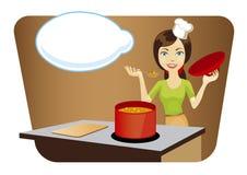 Junge schöne Frau, die in der Küche kocht Lizenzfreie Stockfotografie