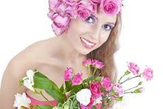 Junge schöne Frau mit Blumen Stockfoto