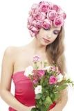 Junge schöne Frau mit rosafarbenen Blumen Lizenzfreies Stockbild