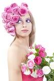 Junge schöne Frau mit rosafarbenen Blumen Stockbilder