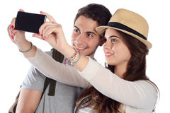 Junge schöne Paare auf einer Reise und einem nehmen selfie Stockfotos
