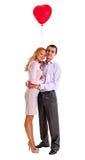 Junge schöne Paare mit Innerballon Stockfotos