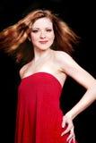 Junge schöne reizvolle Frau im roten Kleid Lizenzfreie Stockbilder