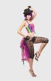 Junge Schönheitsfrau im Discokostüm Stockfoto