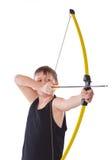 Junge schießt einen Bogen Stockfotografie