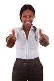 Junge schwarze Frau, die zwei Daumen bildet Stockfotografie