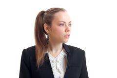 Junge sexy Geschäftsfrau mit dem Pferdeschwanz blickt in Richtung der Nahaufnahme Lizenzfreie Stockbilder