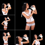 Junge sexy Schönheit mit der Milch, lokalisiert auf Schwarzem Stockfotografie